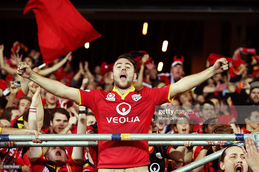 Spectators and members of the Red Army celebrate after the 2015/16 A-League Grand Final match between Adelaide United and the Western Sydney Wanderers at the Adelaide Oval on May 1, 2016 in Adelaide, Australia.