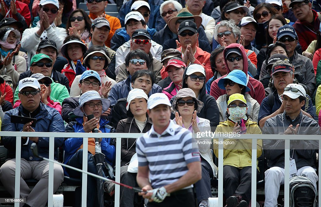 Spectators applaud as Brett Rumford of Australia is introduced on the first tee during the third round of the Ballantine's Championship at Blackstone Golf Club on April 27, 2013 in Icheon, South Korea.