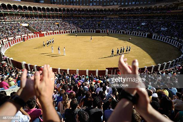 Spectators applauds during the start of the Liga de Corte Puro finals at the Plaza de Toros on September 6 2015 in Valladolid Spain The art consists...
