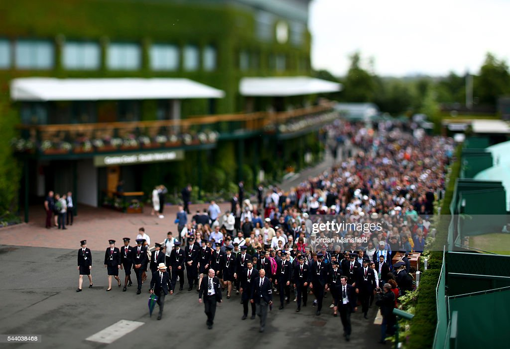 Spectators are led into the grond by security ahead of the start of day four of the Wimbledon Lawn Tennis Championships at the All England Lawn Tennis and Croquet Club on July 1, 2016 in London, England.