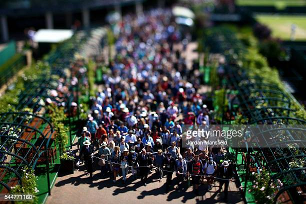 Spectators are led into the grond by security ahead of the start of day seven of Wimbledon Lawn Tennis Championships at the All England Lawn Tennis...