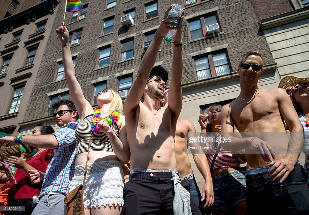 Spectators are seen as people march during the New York City Pride March, June 26, 2016 in New York City. This year was the 46th Pride march in New York City
