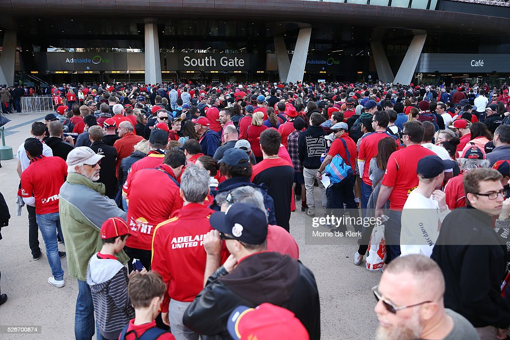 Spectators arrive at the 2015/16 A-League Grand Final match between Adelaide United and the Western Sydney Wanderers at the Adelaide Oval on May 1, 2016 in Adelaide, Australia.