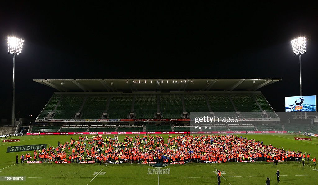 Spectators attempt to break a world record for the most number of people wearing high visibility clothing in one place at the same time after the round 15 Super Rugby match between the Western Force and the Highlanders at nib Stadium on May 25, 2013 in Perth, Australia.