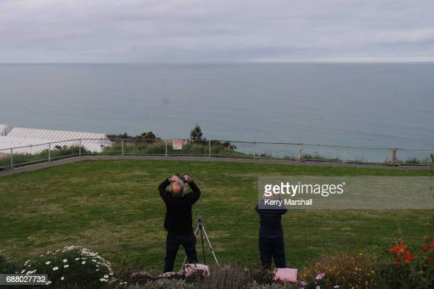 Spectators attempt to follow the rocket after it was hidden from view by low clouds on May 25 2017 in Napier New Zealand After three failed attempts...