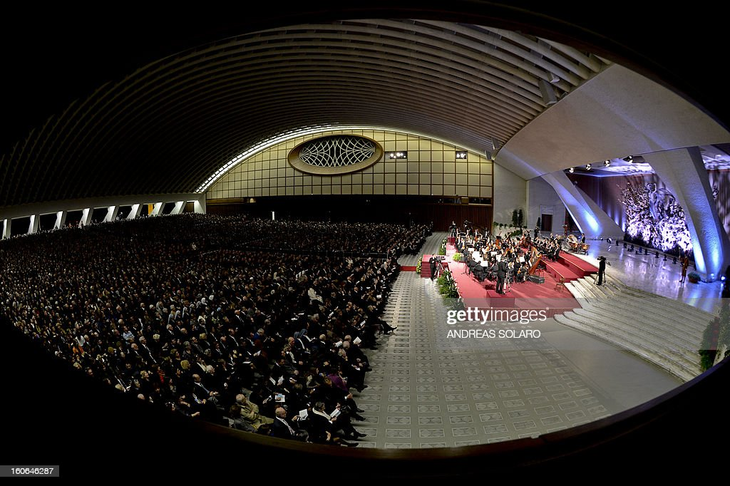 Spectators attend a concert by the Orchestra del Maggio Fiorentino, directed by Indian conductor Zubin Metha, to celebrate the 84th Lateran pact's anniversary on February 4, 2013, at the Sala Nervi in Vatican city.