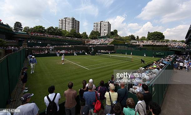 Spectators attend day two of the 2014 Wimbledon Championships at The All England Tennis Club in Wimbledon southwest London on June 24 2014 AFP PHOTO...