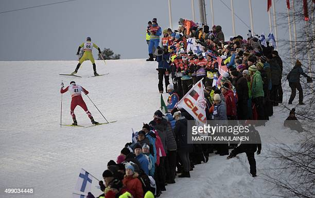 Spectators attend the men's 10km competiton at the FIS cross country World Cup Ruka Nordic 2015 event in Kuusamo Finland on November 28 2015 AFP...