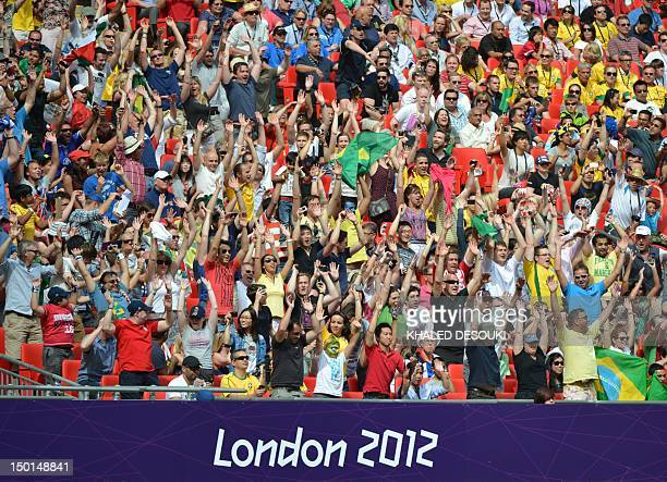 Spectators attend the men's football final match between Brazil and Mexico at the Wembley stadium in London during the London Olympic Games on August...