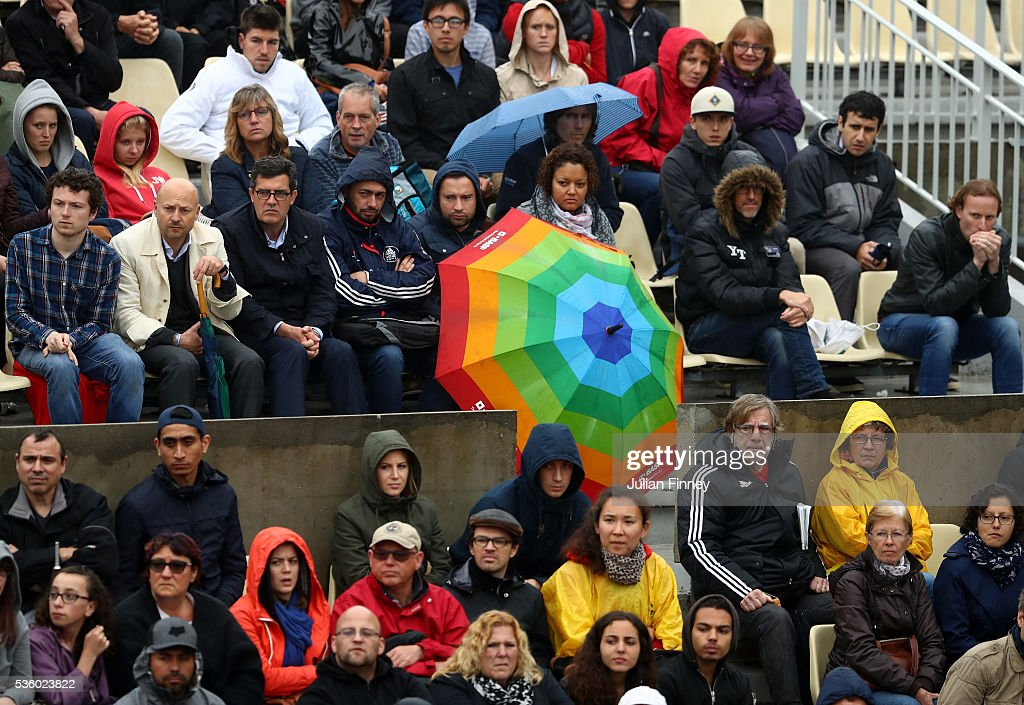 Spectators brave the elements to watch play on day ten of the 2016 French Open at Roland Garros on May 31, 2016 in Paris, France.