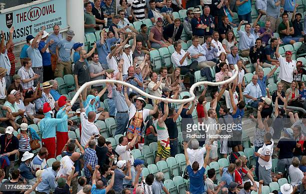 Spectators build a beer snake out of used plastic pint cups during day three of the 5th Investec Ashes Test match between England and Australia at...