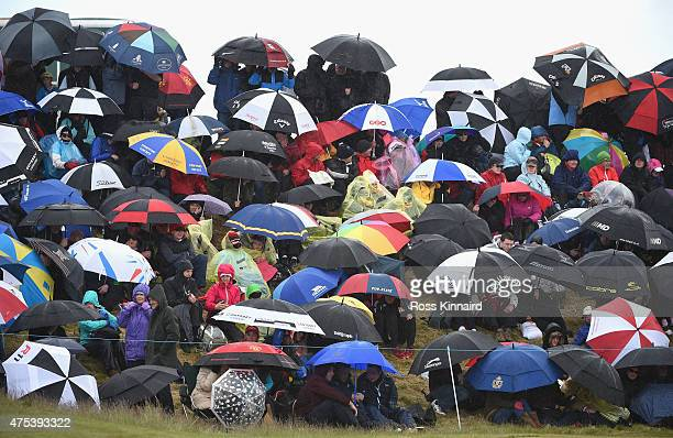 Spectators by the 18th green shelter under umbrellas during the Final Round of the Dubai Duty Free Irish Open Hosted by the Rory Foundation at Royal...