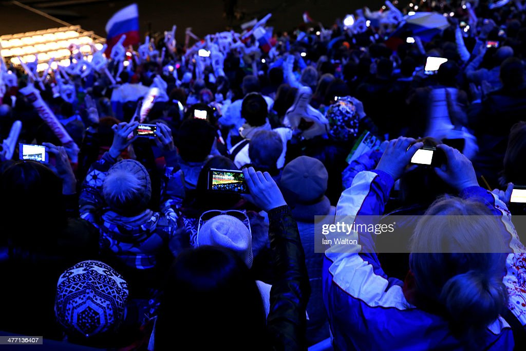 Spectators capture images of the Russian team on their smartphones during the Opening Ceremony of the Sochi 2014 Paralympic Winter Games at Fisht Olympic Stadium on March 7, 2014 in Sochi, Russia.