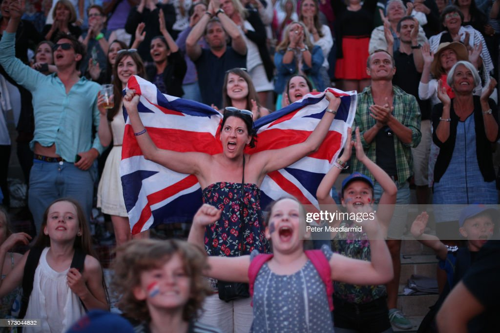 Spectators celebrate Andy Murray of Great Britain's win in the men's singles semi final match against Jerzy Janowicz of Poland on day eleven of the Wimbledon Lawn Tennis Championships at the All England Lawn Tennis and Croquet Club on July 5, 2013 in London, England.