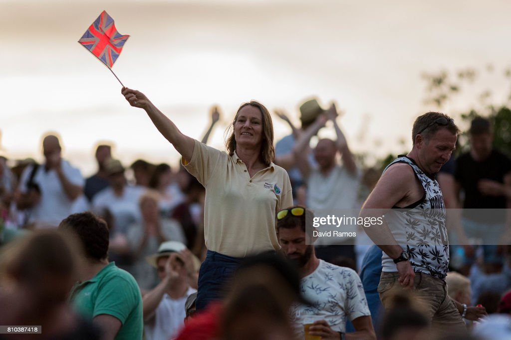 Spectators celebrate Andy Murray's victory over Fabio Fognini during their Gentlemen's Singles second round match from 'Murray Mound' on day five of the Wimbledon Lawn Tennis Championships at the All England Lawn Tennis and Croquet Club on July 7, 2017 in London, England.