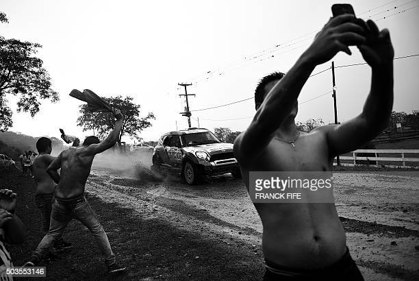 Spectators cheer and take selfies as driver Erik Van Loon and codriver Wouter Rosegaar both from the Netherlands compete in the Stage 3 of the 2016...