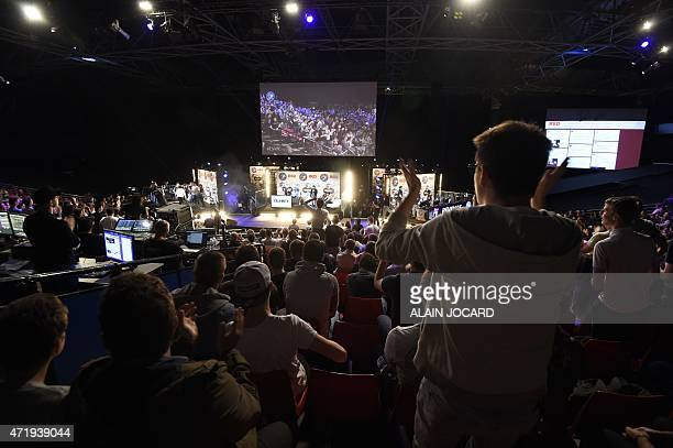 Spectators cheer competitors playing Call of Duty Advanced Warfare during the ESWC on May 2 2015 in Paris The video game event gather the eight world...