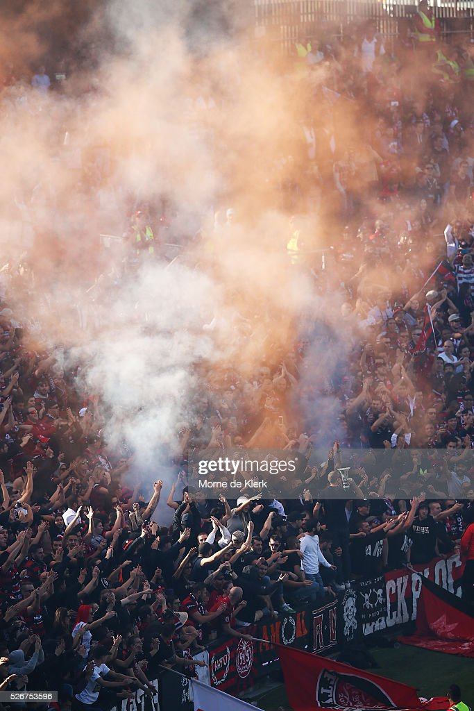 Spectators cheer during the 2015/16 A-League Grand Final match between Adelaide United and the Western Sydney Wanderers at the Adelaide Oval on May 1, 2016 in Adelaide, Australia.