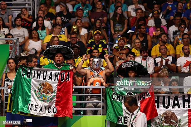 Spectators cheer during the boxing event on Day 13 of the 2016 Rio Olympic Games at Riocentro Pavilion 6 on August 18 2016 in Rio de Janeiro Brazil