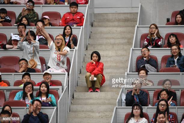 Spectators cheer during the match between Juan Martin Del Potro of Argentina and Pablo Cuevas of Uruguay at the China Open tennis tournament in...
