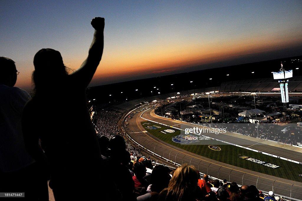 Spectators cheer during the NASCAR Nationwide Series Virginia 529 College Savings 250 at Richmond International Raceway on September 7, 2012 in Richmond, Virginia.