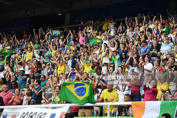 Spectators cheer during the Rio 2016 Paralympic Games at Olymic stadium on September 9 2016 in Rio de Janeiro Brazil