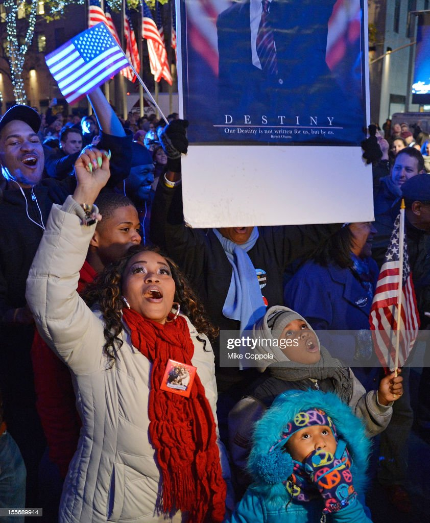 Spectators cheer in celebration of the 2012 Presidential election night on November 6, 2012 in Times Square, New York City.