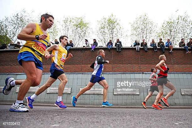 Spectators cheer on the competitors during the Virgin Money London Marathon on April 26 2015 in London England