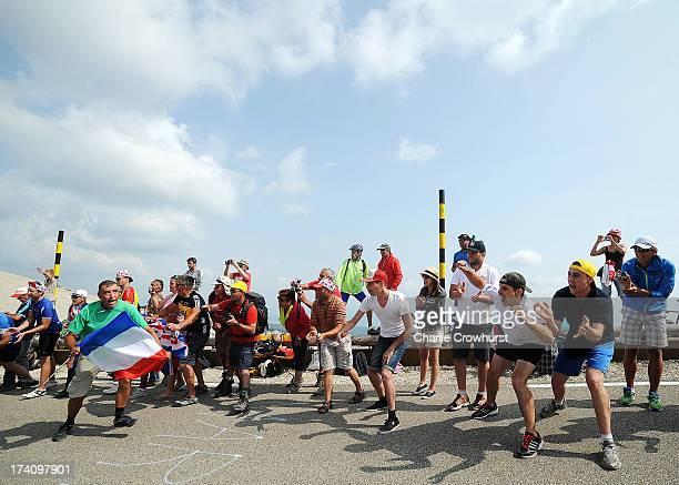 Spectators cheer on the riders at the top of Mont Ventoux during stage fifteen of the 2013 Tour de France a 2425KM road stage from Givors to Mont...