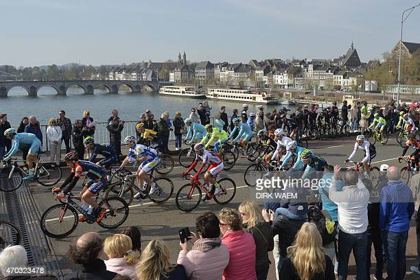 Spectators cheer riders at the start of the 50th edition of the Amstel Gold race between Maastricht and Berg en Terblijt on April 19 2015 AFP PHOTO /...