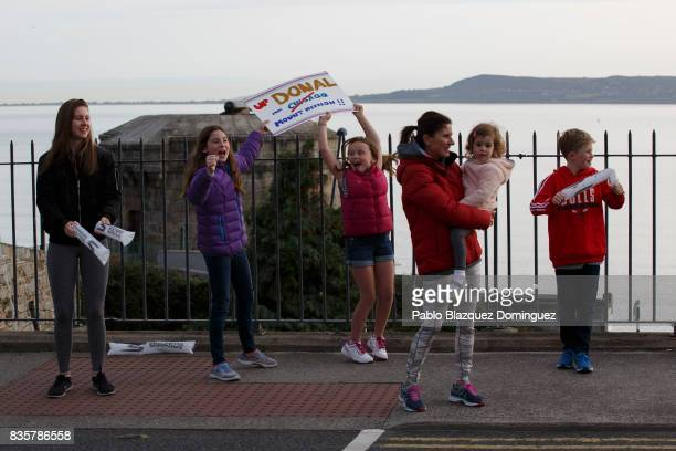 Spectators cheer the athletes during the bike leg of IRONMAN 703 Dublin on August 20 2017 in Dublin Ireland