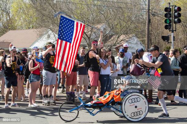 Spectators cheer the runners as they make their way past the 6 mile mark of the Boston Marathon on April 17 2017 in Framingham Massachusetts