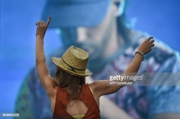 Spectators cheer while 'PNL' performs during the 29th Eurockeennes rock music festival on July 6 2017 in Belfort eastern France / AFP PHOTO /...