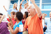 Spectators Cheering At Outdoor Sports Event Celebrating