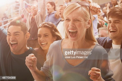 Spectators cheering at sporting event
