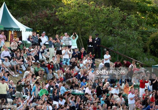 Spectators cheers as they watch the match between Great Britain's Andy Murray and France's Richard Gasquet during the Wimbledon Championships 2008 at...