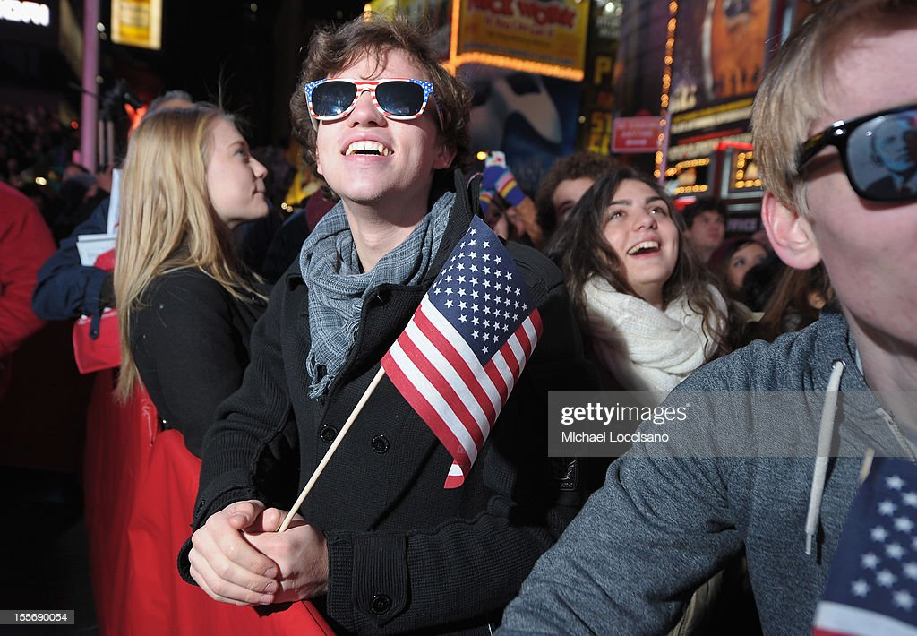 Spectators come out in celebration of the 2012 Presidential Election night in Times Square on November 6, 2012 in New York City.