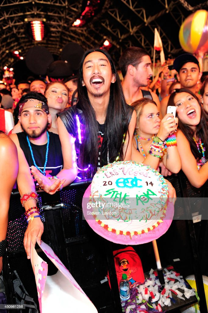 Spectators dance as DJ/producer Steve Aoki performs at the 18th annual Electric Daisy Carnival at Las Vegas Motor Speedway on June 21, 2014 in Las Vegas, Nevada.