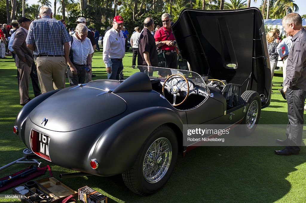 Spectators discuss the condition of a 1953 166 MM antique Ferrari automobile at the annual Cavallino Auto Competition, January 26, 2013 held at The Breakers Hotel in Palm Beach, Florida.
