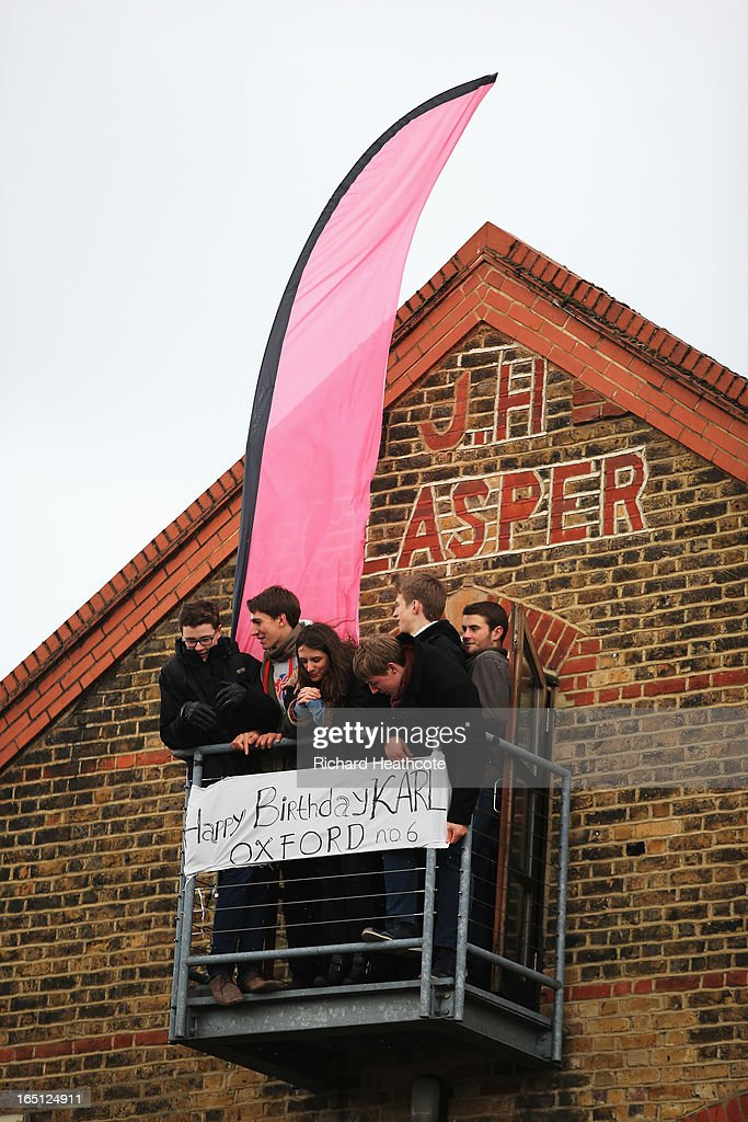 Spectators display a message for Karl Hudspith of Oxford prior to the BNY Mellon 159th Oxford versus Cambridge University Boat Race on The River Thames on March 31, 2013 in London, England.