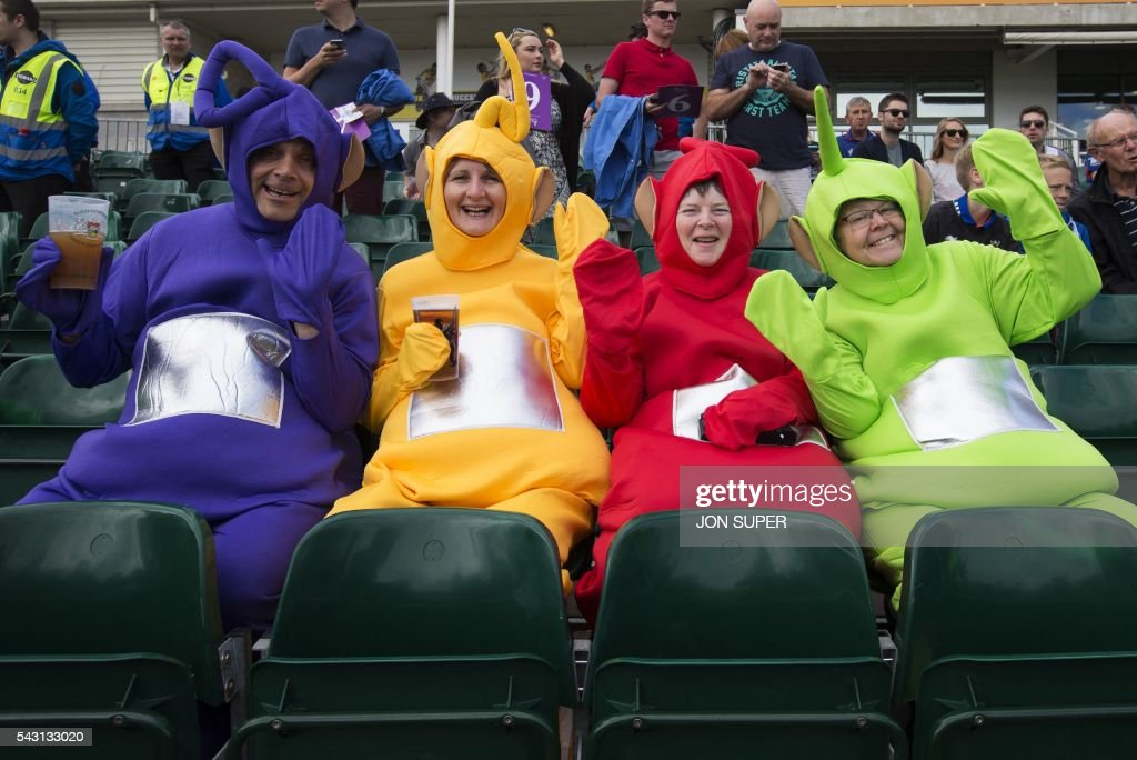 Spectators dressed as characters from the childrens' television series 'The Teletubbies' sit in the stands ahead of play in the third one day international (ODI) cricket match between England and Sri Lanka at Bristol cricket ground in Bristol, south-west England, on June 26, 2016. / AFP / JON