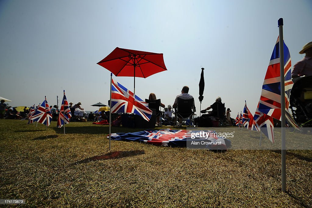 Spectators enjoy a day out during the The Veuve Clicquot Gold Cup for the British Open Polo Championship Final between Dubai and Zacara at Cowdray Park Polo Club on July 21, 2013 in Midhurst, England.