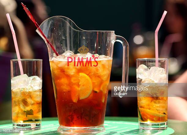 Spectators enjoy a traditional pitcher of Pimms on Day Three of the Wimbledon Lawn Tennis Championships at the All England Lawn Tennis and Croquet...