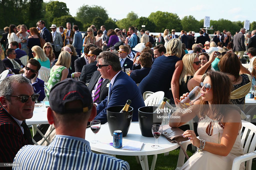 Spectators enjoy an afternoon drink in the members enclosure during day two of the Hnley Royal Regatta on July 4, 2013 in Henley-on-Thames, England.