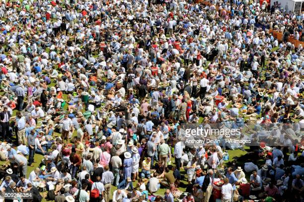 Spectators enjoy lunch on the nursery ground at the lunch interval during the Second npower Test match at Lord's Cricket Ground London