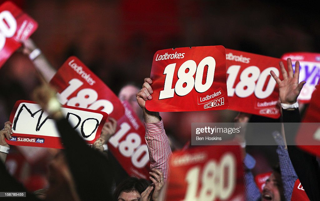Spectators enjoy the atmosphere during day twelve of the 2013 Ladbrokes.com World Darts Championship at the Alexandra Palace on December 28, 2012 in London, England.
