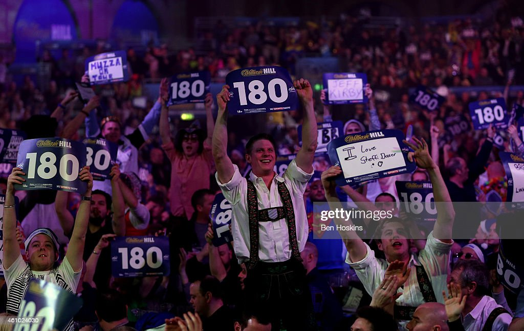Spectators enjoy the atmosphere during the final of the 2015 William Hill PDC World Darts Championships at Alexandra Palace on January 4 2015 in...