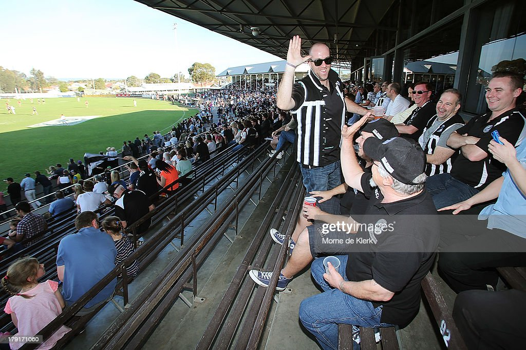 Spectators enjoy the atmosphere during the round 22 SANFL match between the Port Adelaide Magpies and the West Adelaide Bloods at Alberton Oval on September 1, 2013 in Adelaide, Australia.