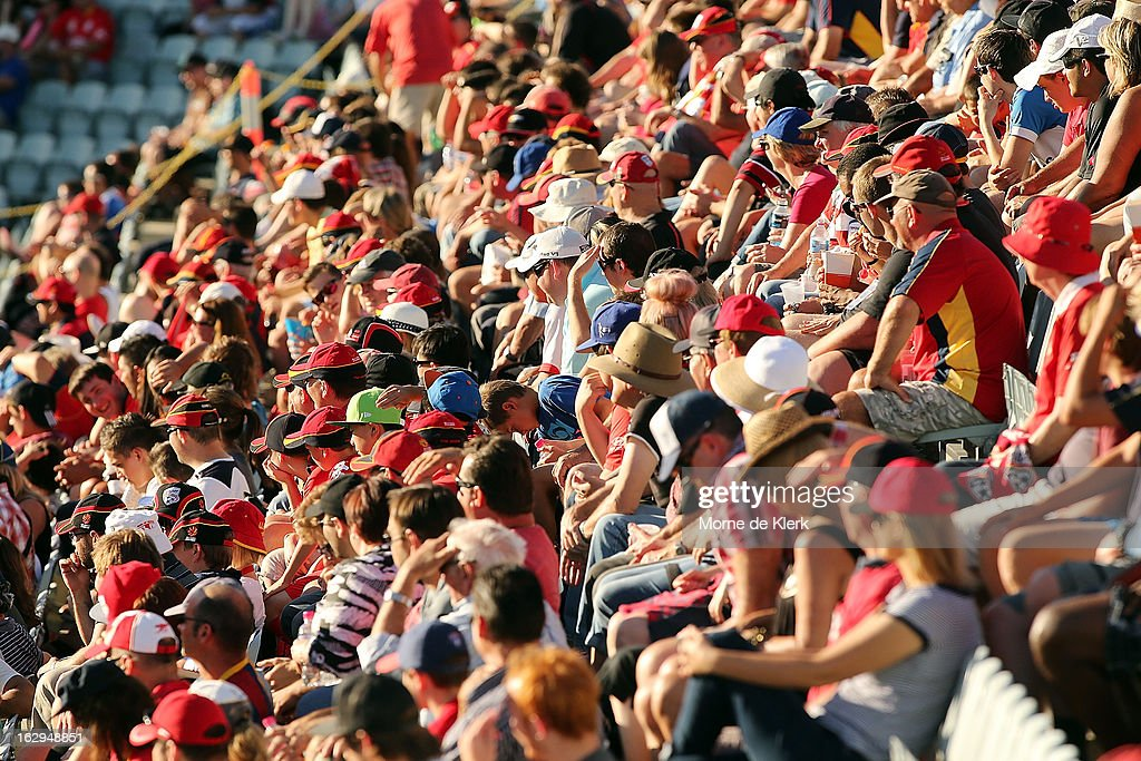 Spectators enjoy the atmosphere during the round 23 A-League match between Adelaide United and the Brisbane Roar at Hindmarsh Stadium on March 2, 2013 in Adelaide, Australia.