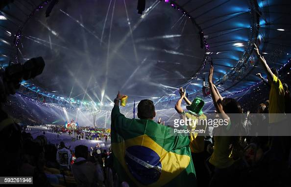Spectators enjoy the atmosphere of the 'Cidade Maravilhosa' segment during the Closing Ceremony on Day 16 of the Rio 2016 Olympic Games at Maracana...